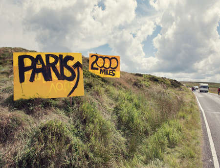 silliness: Handmade yellow direction signs on rural roadside for Tour de France, Hebden Bridge, Yorkshire, Uk