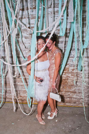 inebriated: Bride and friend, standing together at wedding