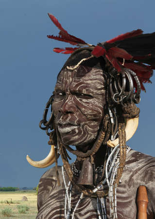 ethiopian ethnicity: Portrait of man from Mursi tribe decorated with face paint, Ethiopia, Africa LANG_EVOIMAGES