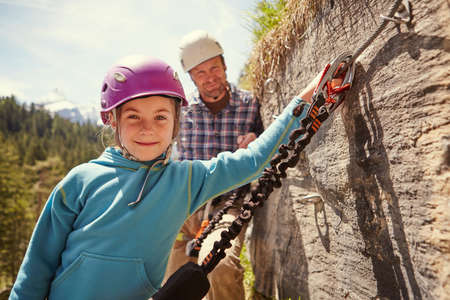 Father and child rock climbing, Ehrwald, Tyrol, Austria