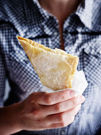 Mid section of mid adult man holding bougatsa custard pie LANG_EVOIMAGES