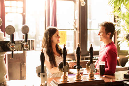 30 years old man: Couple talking in bar LANG_EVOIMAGES