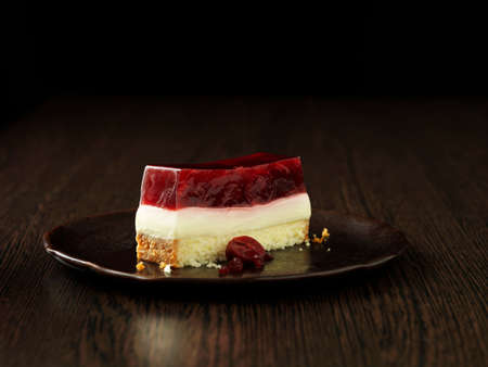 berry: Morello cherry and almond terrine on brown ceramic plate LANG_EVOIMAGES