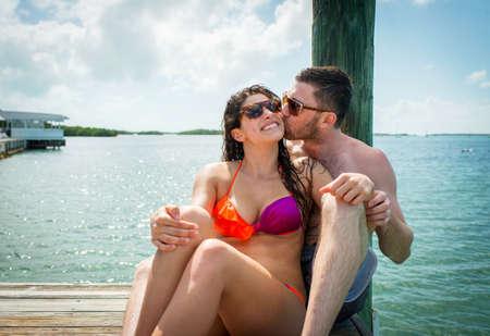 smooching: Young couple on sea pier, Islamorada, Florida, USA