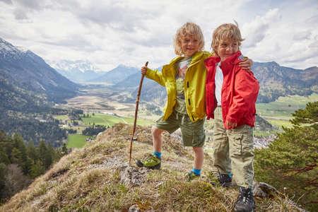 living idyll: Portrait of two young boys, standing on hilltop, Garmisch-Partenkirchen, Bavaria, Germany