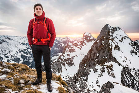 sunrises: Hiker with hands in pockets, Kellenspitze, Tannheim mountains, Tyrol, Austria