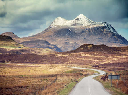 vacant land: Empty road towards mountain, diminishing perspective, Assynt, Scotland