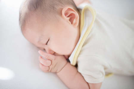 Baby boy sleeping LANG_EVOIMAGES