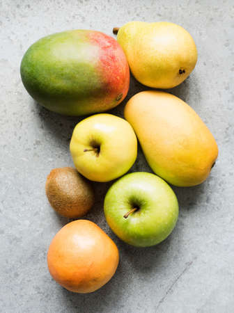 Ripe fruit with apple, mango, kiwi, quince and pear LANG_EVOIMAGES