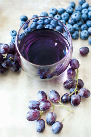 berry: Glass of fruit juice made from blueberries and black grapes LANG_EVOIMAGES