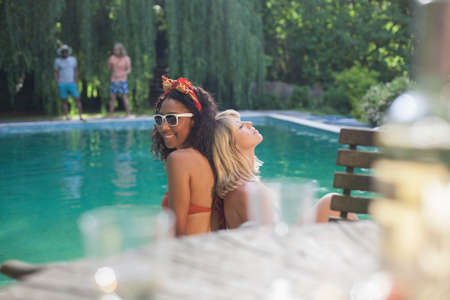 Friends having fun by pool