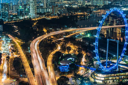 entertaining area: Aerial of highway and The Flyer at night, Singapore LANG_EVOIMAGES