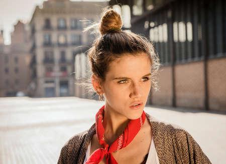 Young woman posing on street, El Born, Barcelona, Spain
