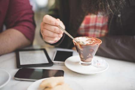 Having dessert in cafe