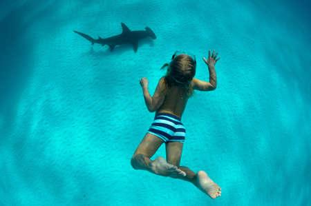 Boy with nurse shark, Bimini, Bahamas