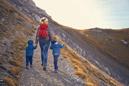 living idyll: Mother and sons, hiking along mountain path, Karwendel-Mittenwald, Bavaria, Germany