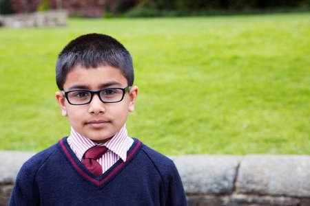 Portrait of boy in school uniform