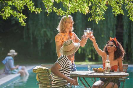 30 years old man: Friends having fun by pool