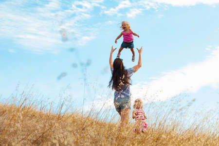 Mother and daughters having fun, Mt Diablo State Park, California, USA LANG_EVOIMAGES