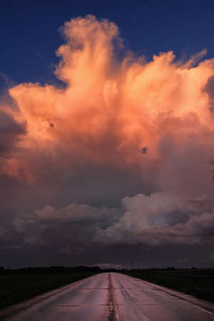 Dissipating thunderstorm reflected in sunset, Dickens, Texas, USA LANG_EVOIMAGES