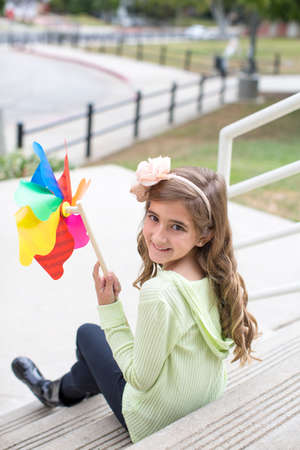 top 7: Girl with paper windmill in park