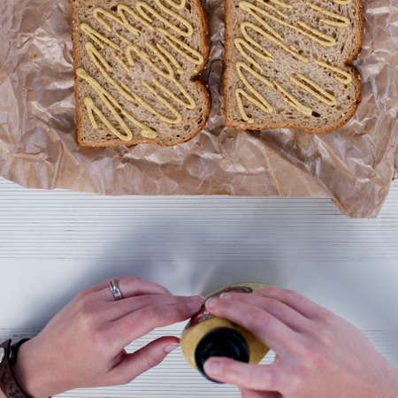 Woman making sandwich, overhead view LANG_EVOIMAGES