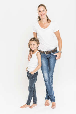 Portrait of mother and daughter, full length