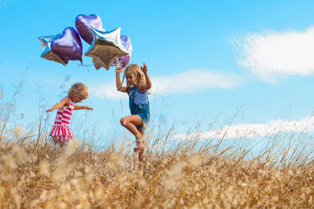 air dried: Girls playing with balloon, Mt Diablo State Park, California, USA