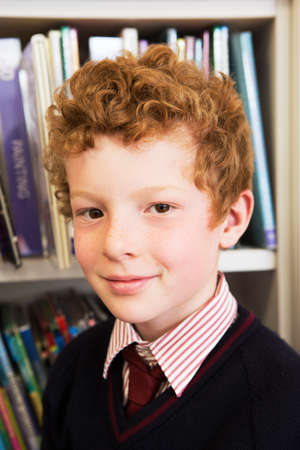 Portrait of boy in library LANG_EVOIMAGES