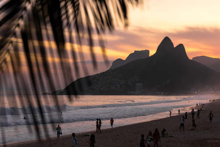 View of Ipanema beach and Morro dois Irmaos at sunset, Rio de Janeiro, Brazil LANG_EVOIMAGES