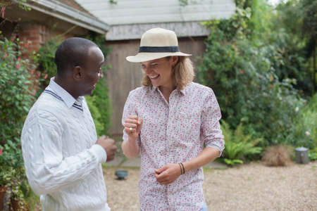 liberating: Two male friends enjoying garden party