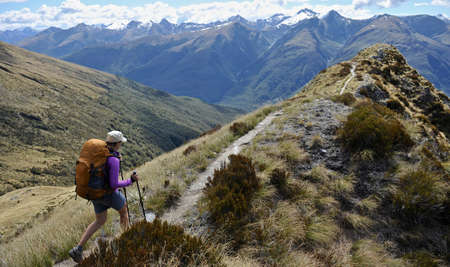 Woman hiking in mountains, New Zealand LANG_EVOIMAGES