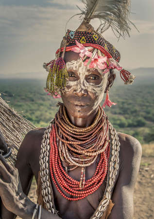 ethiopian ethnicity: Portrait of mature woman from Karo tribe wearing traditional costume, Ethiopia, Africa LANG_EVOIMAGES