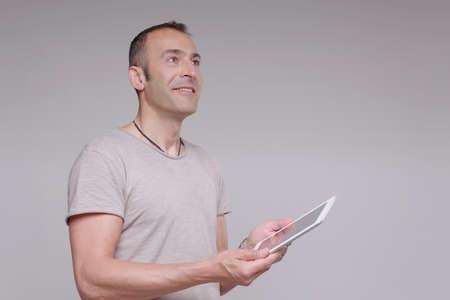 Mature man holding digital tablet LANG_EVOIMAGES