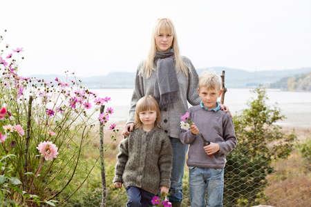 Portrait of mother and children in organic garden, Orust, Sweden