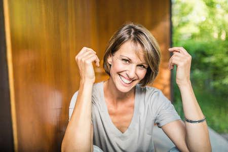 Portrait of mature woman outside house