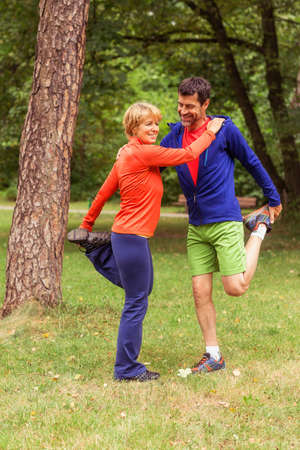 54: Couple exercising, stretching, outdoors