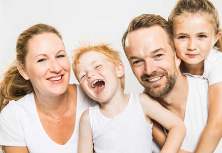 Studio portrait of happy boy and girl with mature parents