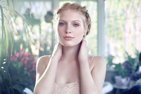 vintage: Portrait of young woman, hands behind neck LANG_EVOIMAGES