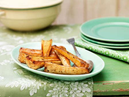 Honey roasted parsnips on green vintage plate