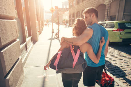 athletic wear: Young couple returning from training LANG_EVOIMAGES