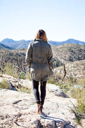 Full length rear view of young woman looking away at mountain range, Chilao Campgrounds, Los Angeles, California, USA