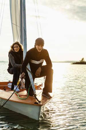 lovers quarrel: Mature couple on sailing boat