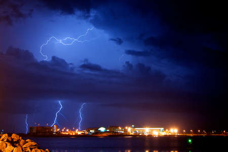 stormy waters:  Lightning over cruise ship terminals at Port Canaveral in Cape Canaveral, Florida, USA, 18 June 2013