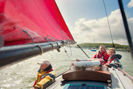 Small group of adults on sailing boat