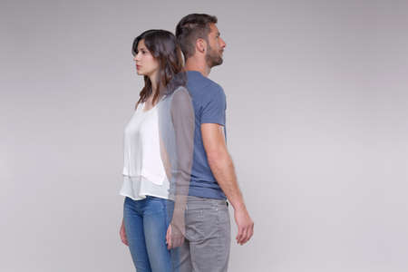Man standing back to back with transparent woman