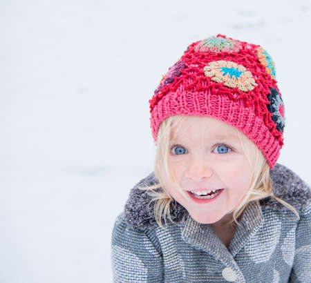 Happy toddler with colourful beanie