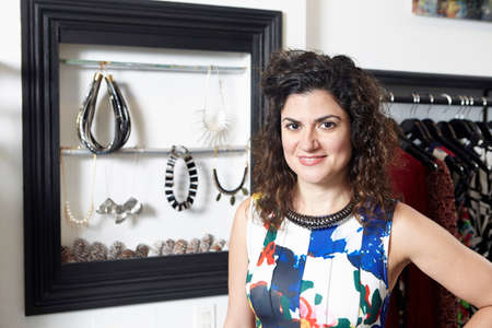 salespeople: Portrait of business owner in fashion boutique