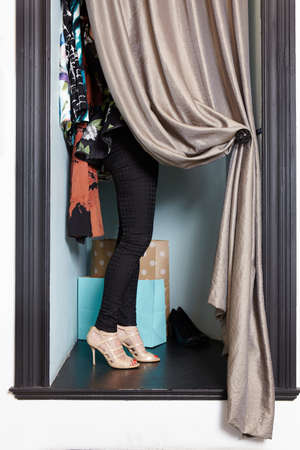 obscuring: Mature woman in fashion boutique, trying on outfit in dressing room