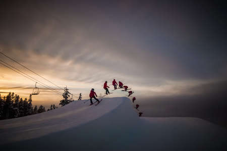 living idyll: Multiple image of skier in mid air doing switch cork 540, Whistler Blackcomb, British Columbia, Canada